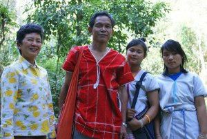 Khun Tuenjai with Mr Preeca Siri, leader of Huay Hin Lard Nai Village, Chiang Rai and his two daughters