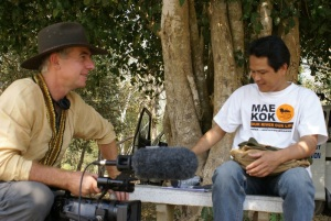 Gavin preparing to film an informal interview with Mr Somkiat Khuenchiangsa, coordinator of the Mekong-Lanna Natural Resource and Culture Conservation network